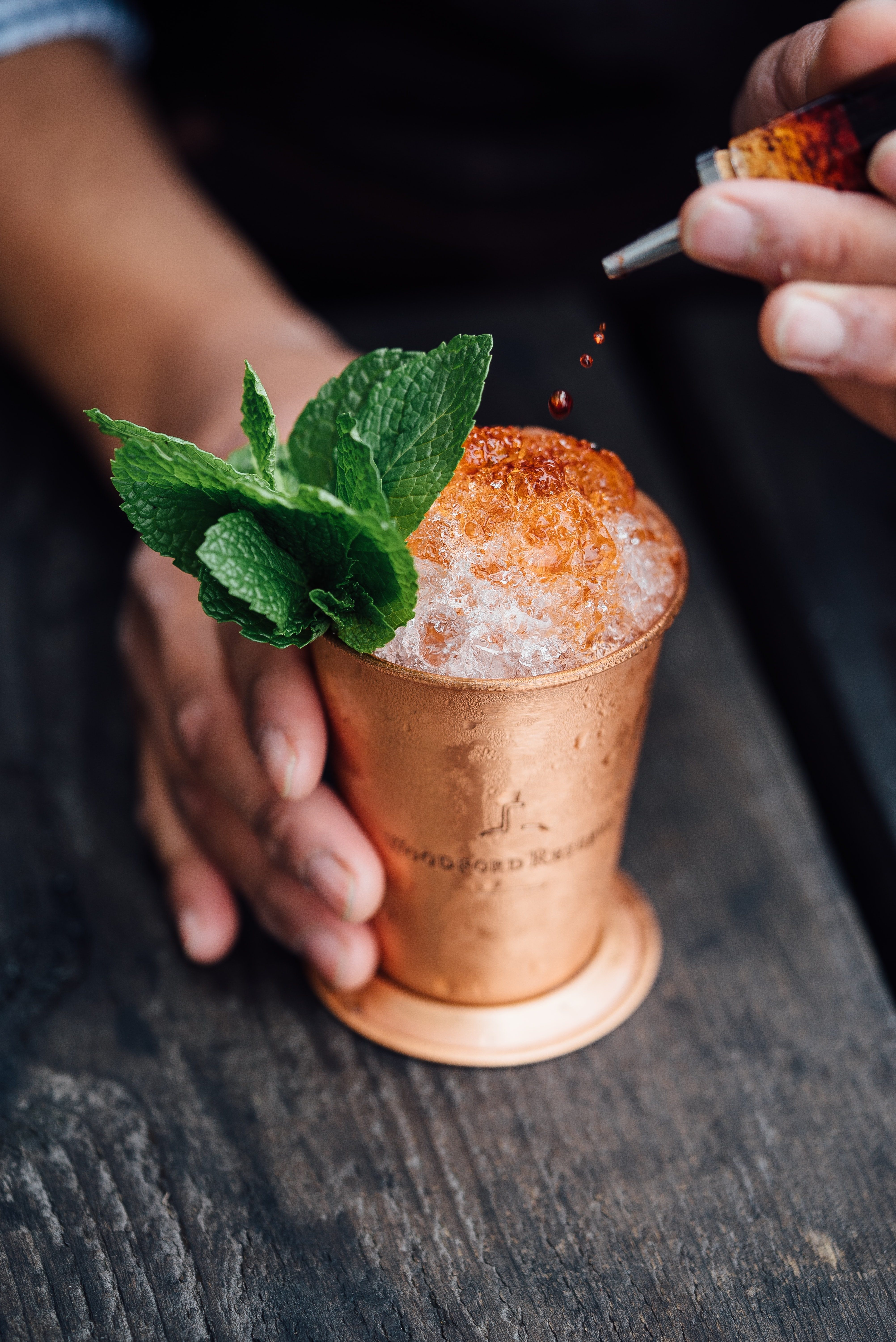 brass-colored cup filled with crushed ice with mint