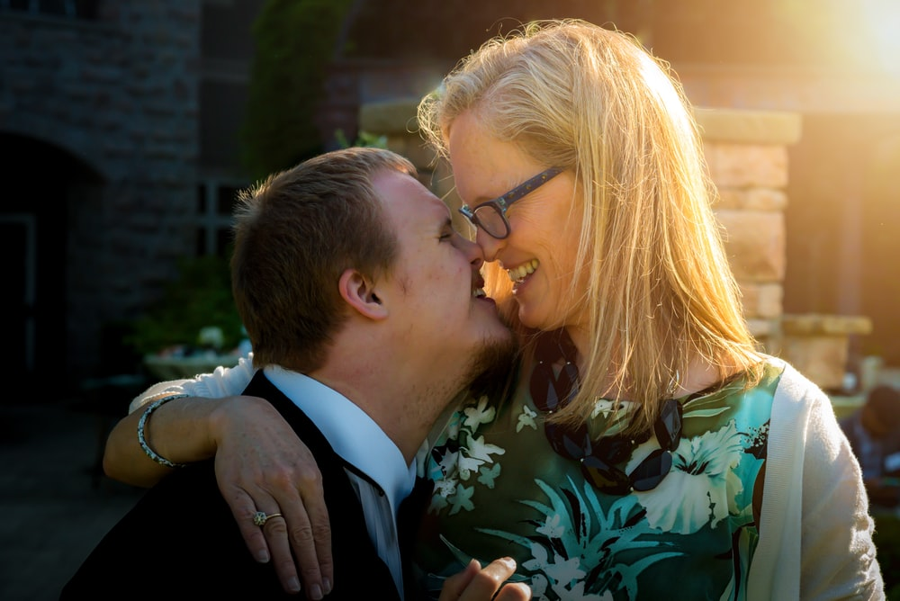 smiling couple kissing during daytime