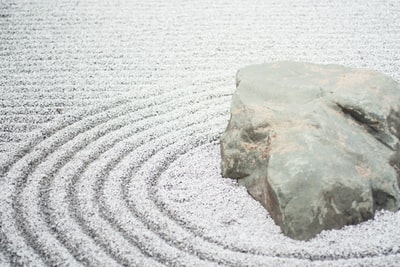 gray stone beside river zen garden zoom background