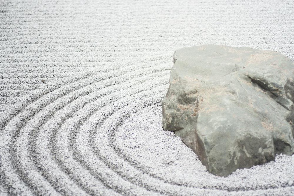 gray stone beside river