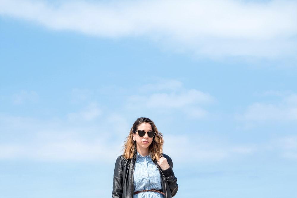 woman wearing black zip-up jacket