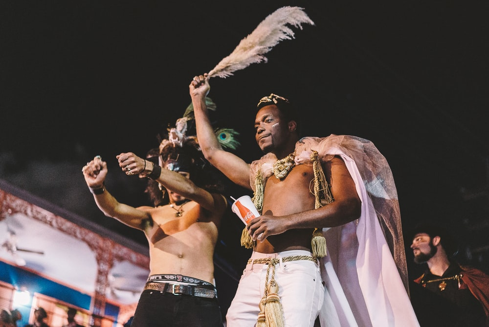 two topless men performing