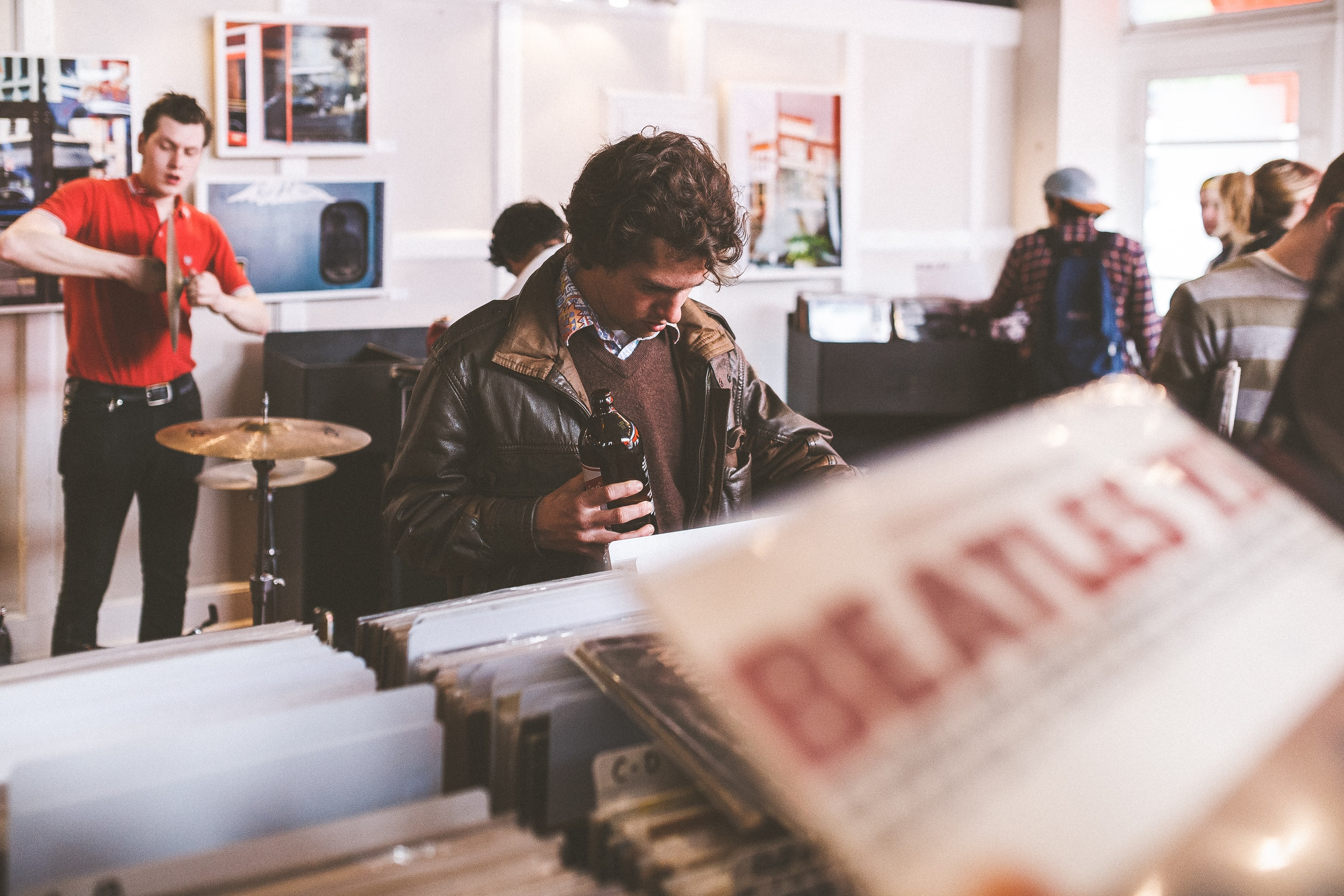Young people browsing the vinyls at a record score