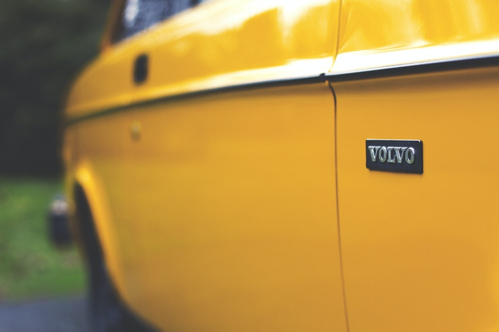 close up photography of yellow Volvo car