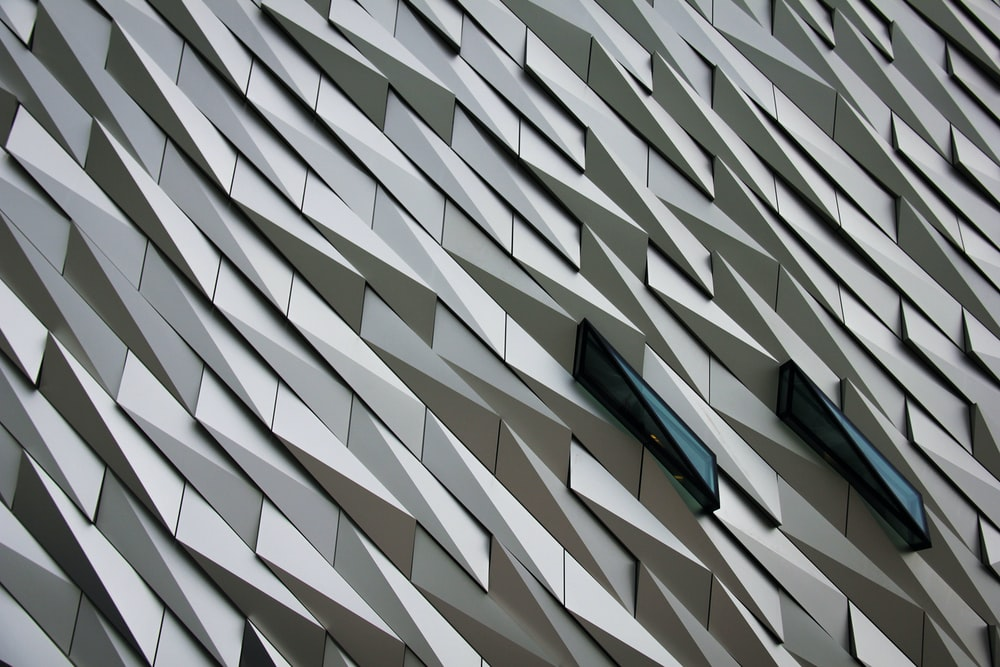 Undulating abstract shapes on a building facade at The Titanic Memorial Garden.