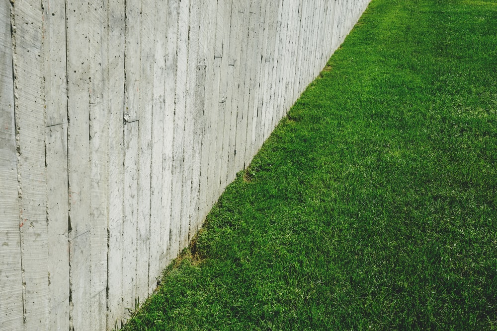 brown wooden fence on green lawn field