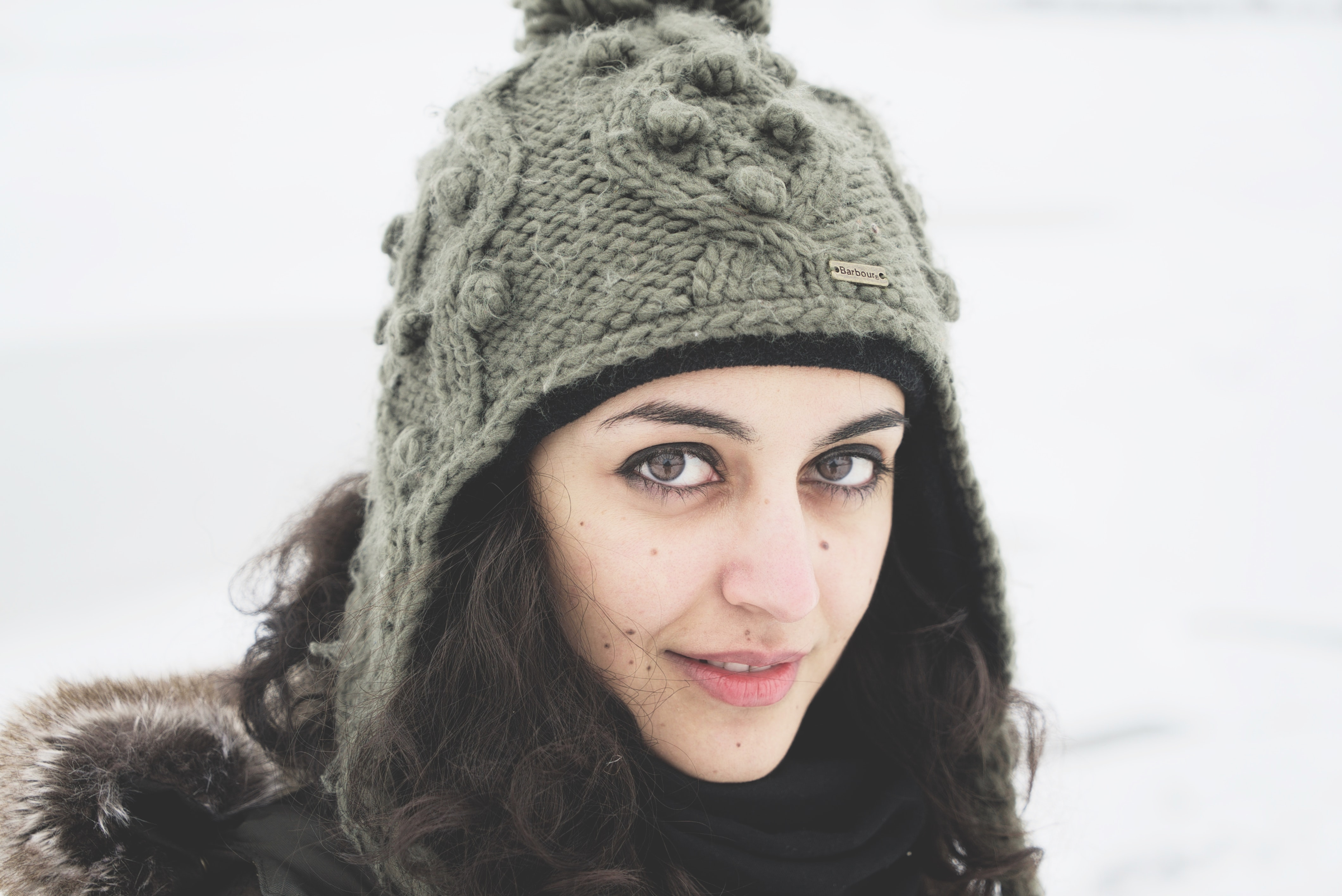 selective focus photography of woman in gray knitted hat