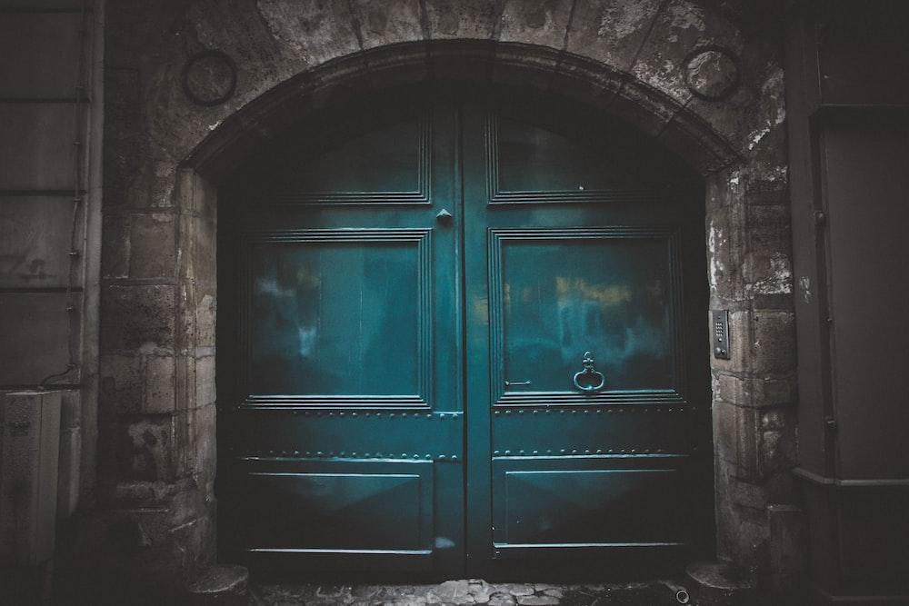 blue wooden double arch door s