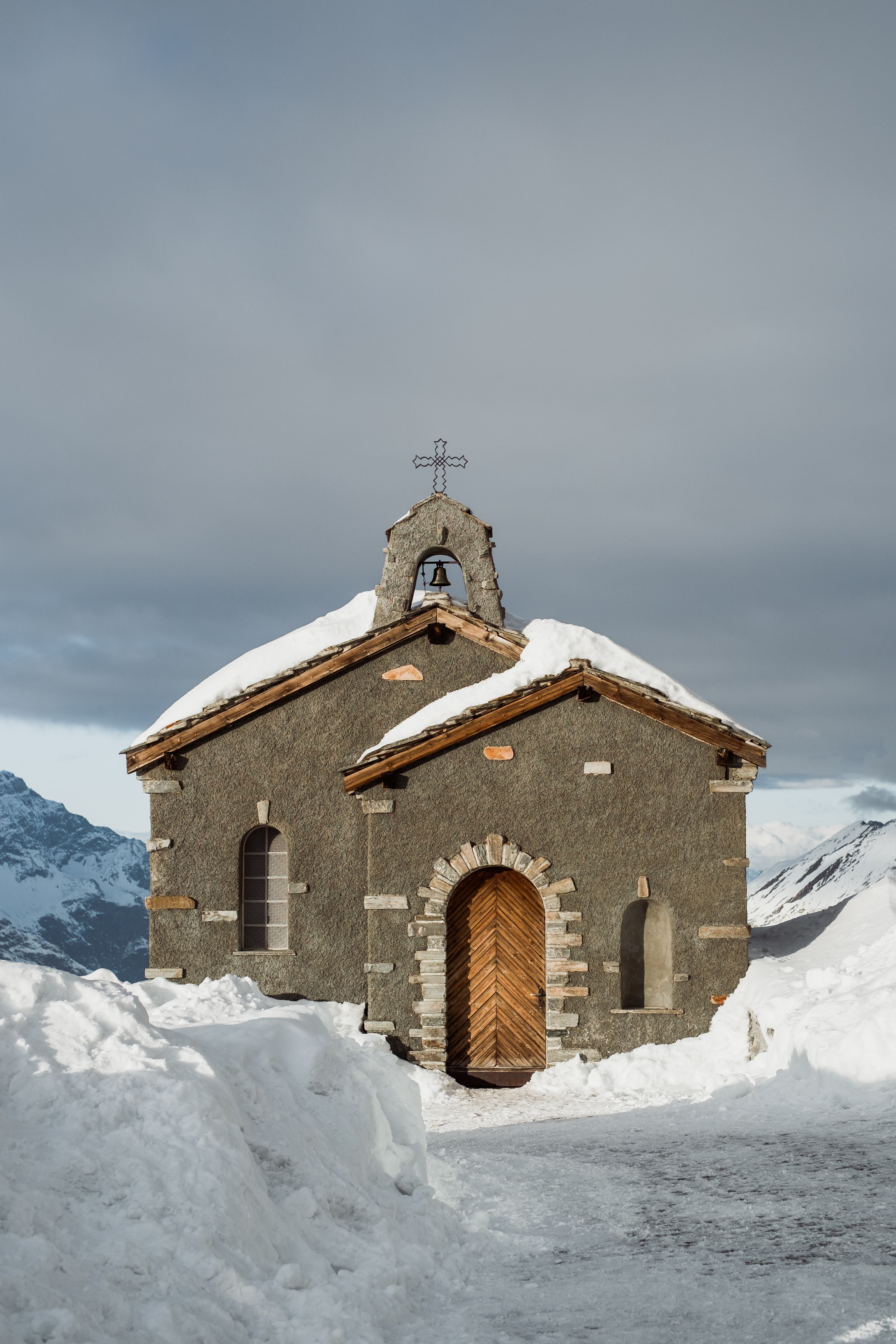 gray and brown cathedral surrounded by snow pile
