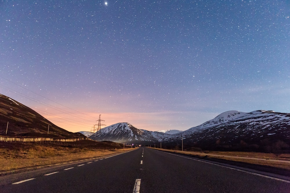 landscape photo of road with mountain