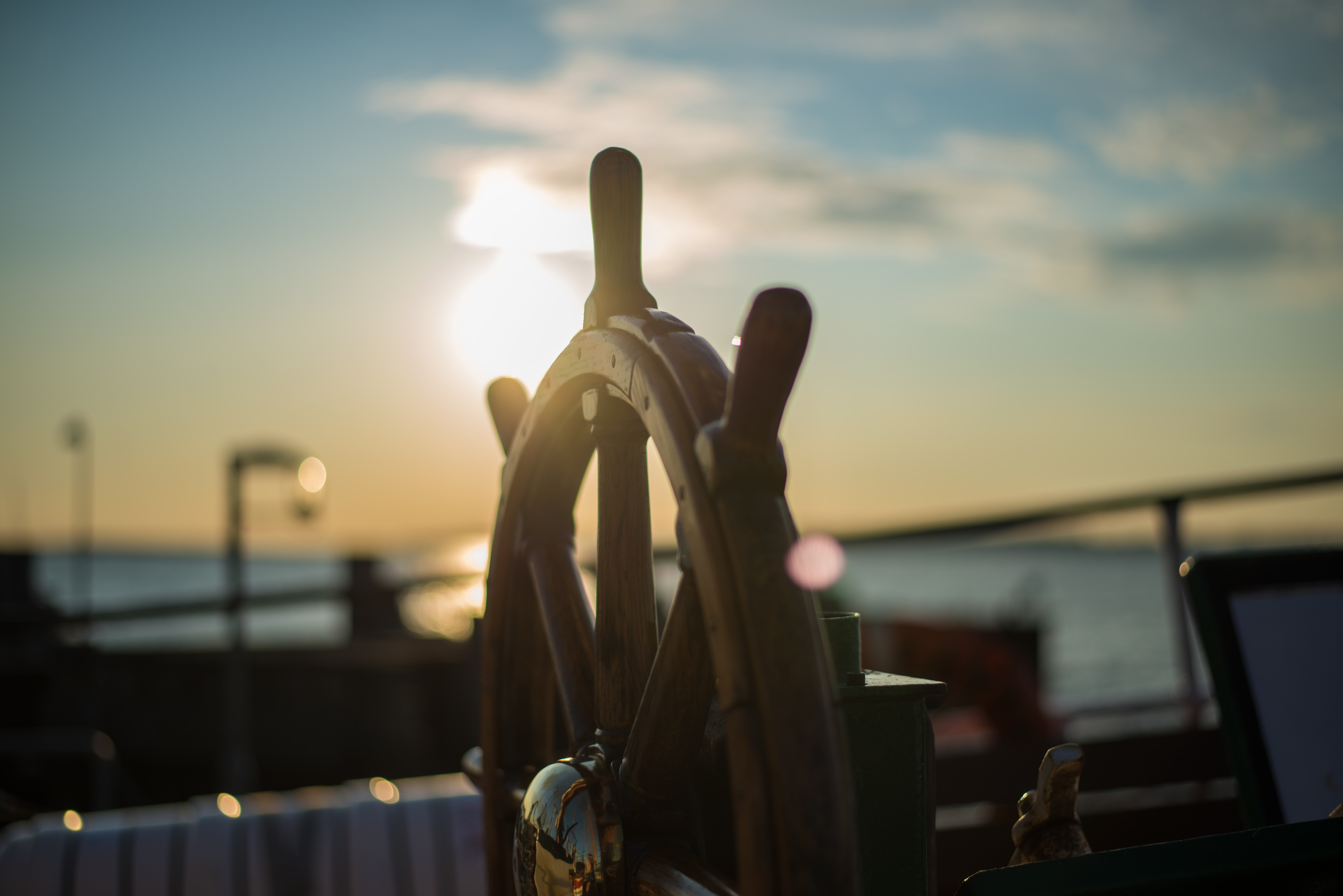 A ship's wheel is seen in Faaborg during sunset.