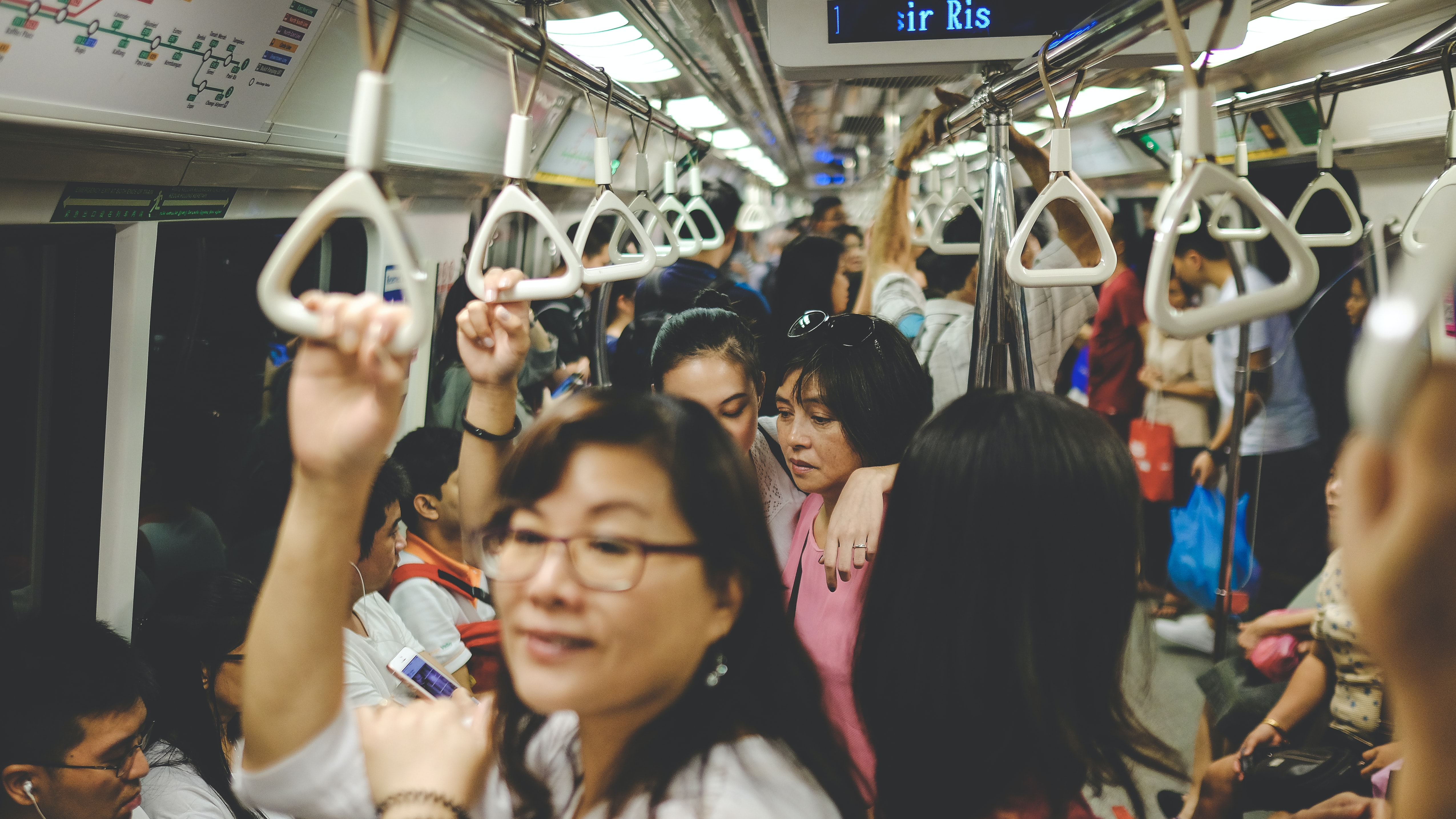 Passengers on a crowded subway train