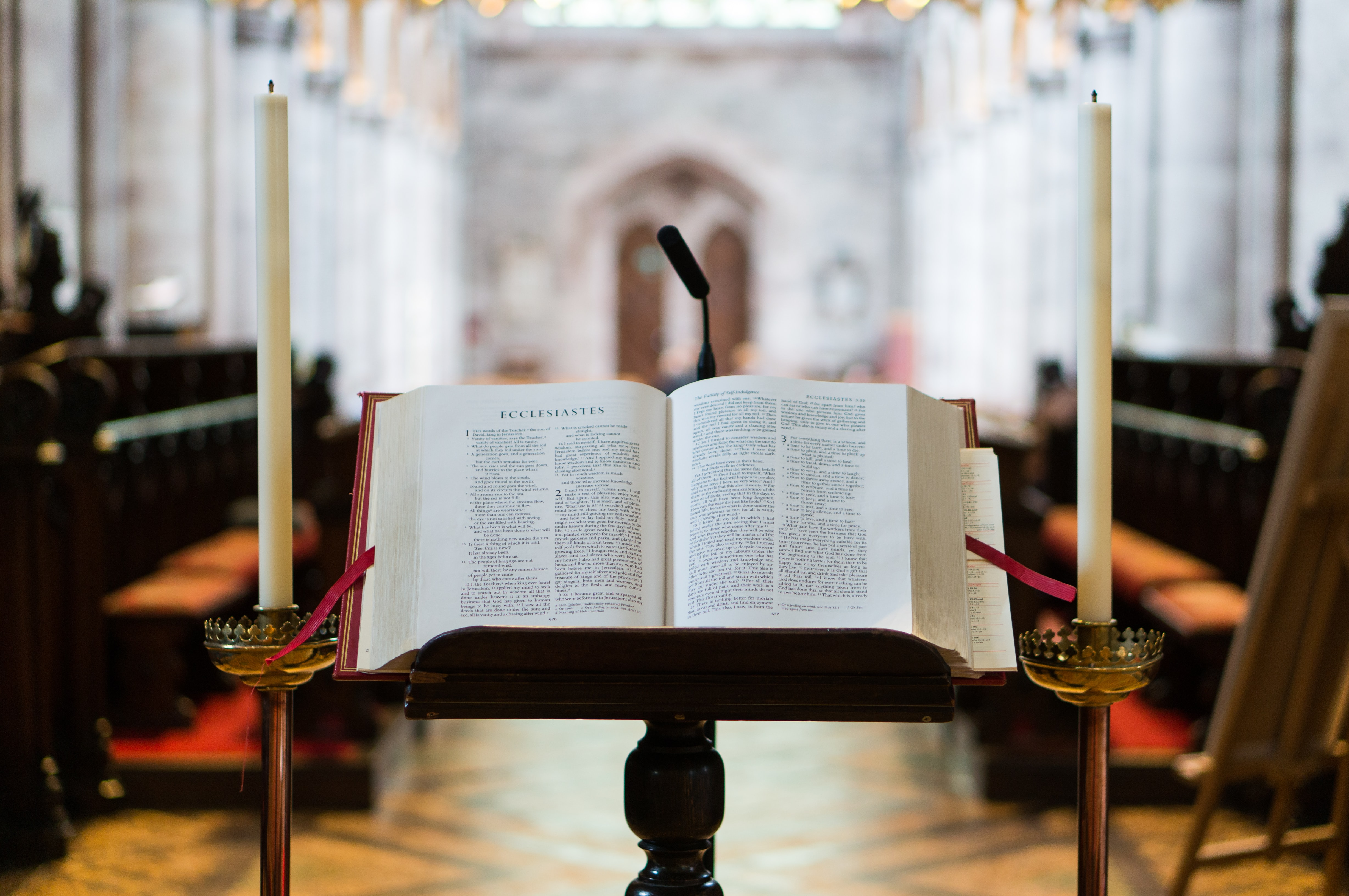 selective focus photography opened Bible on book stand