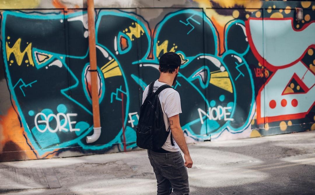 Man looks at graffiti
