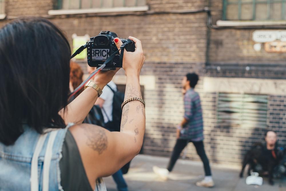 person taking photo on concrete building