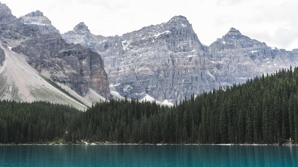 mountain ranges near body of water during daytime