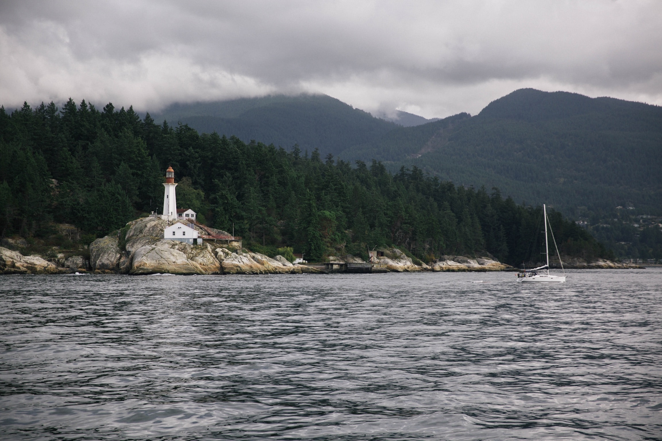 A lighthouse on a rocky shore in Vancouver