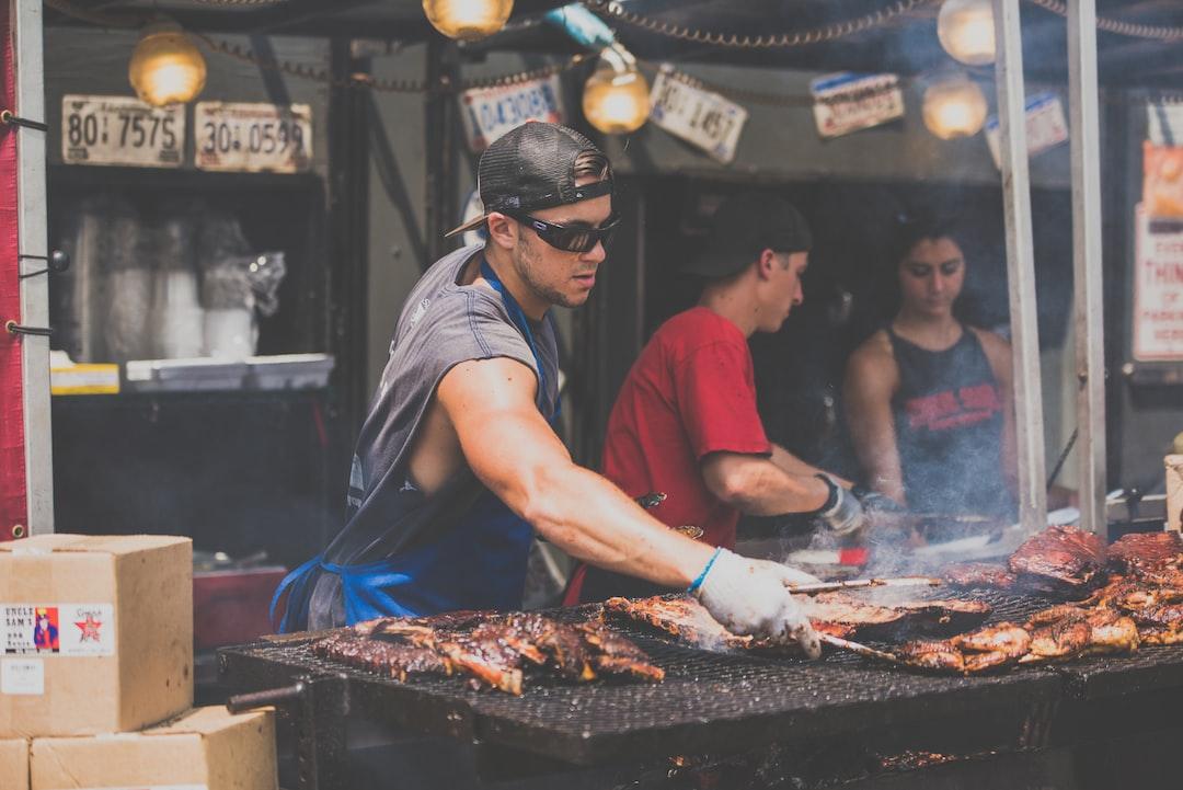 Man cooking pork