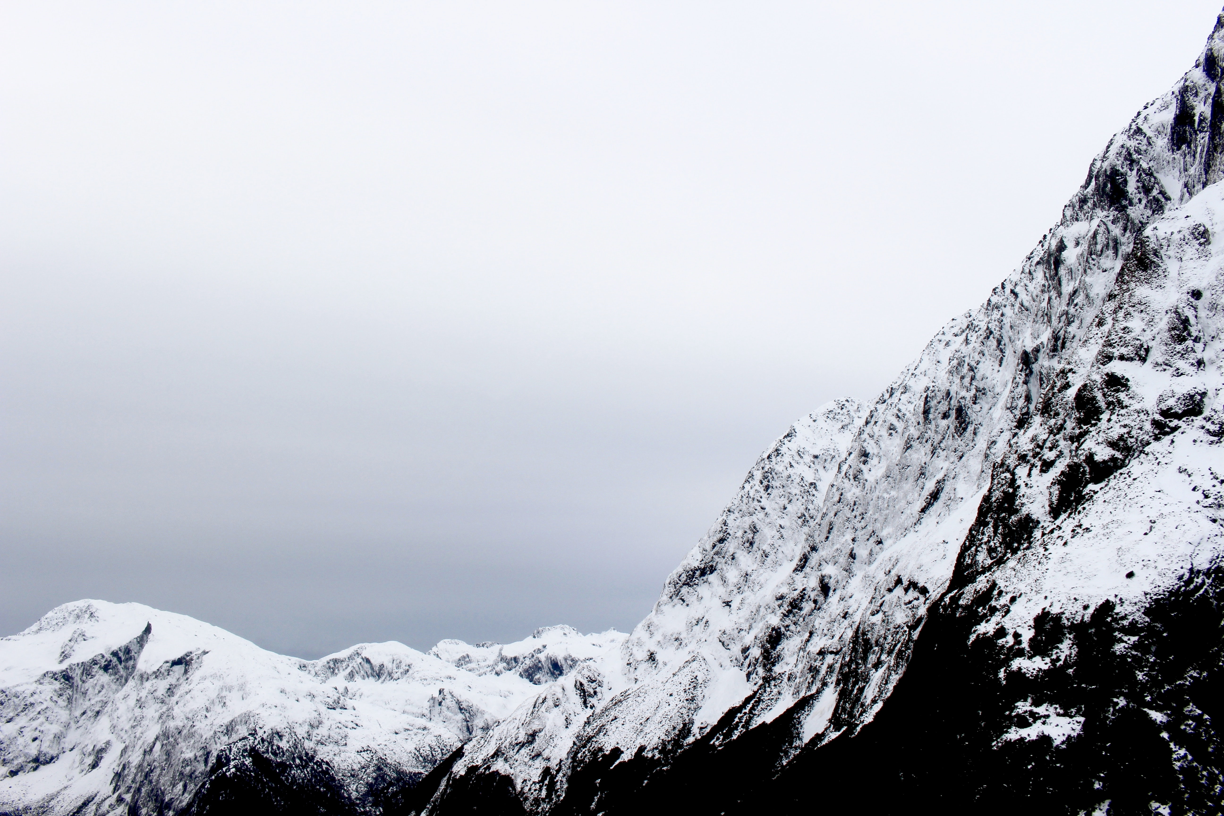 Mountain landscape with snow on a foggy day