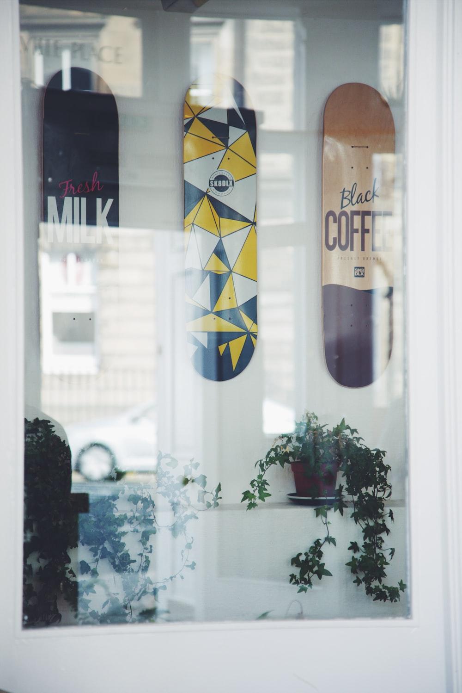 three assorted color skateboard decks