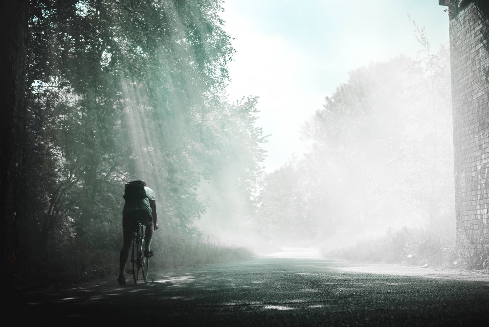 person riding on bicycle during daytime