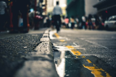 macro photography of water on road urban zoom background