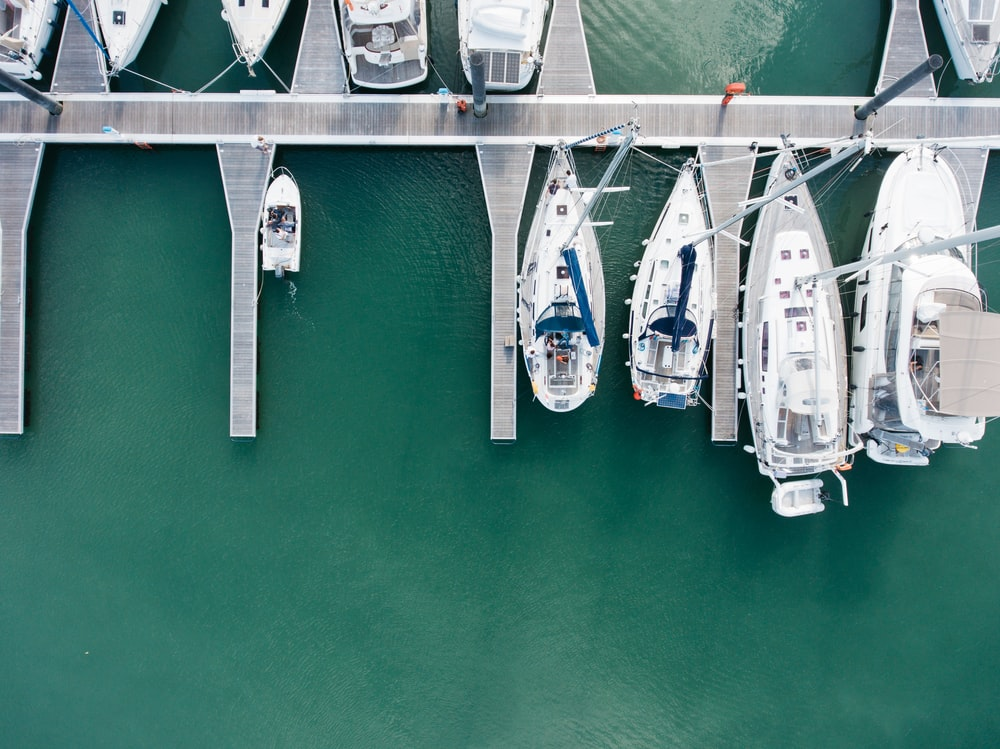 aerial photography of speedboats on body of water