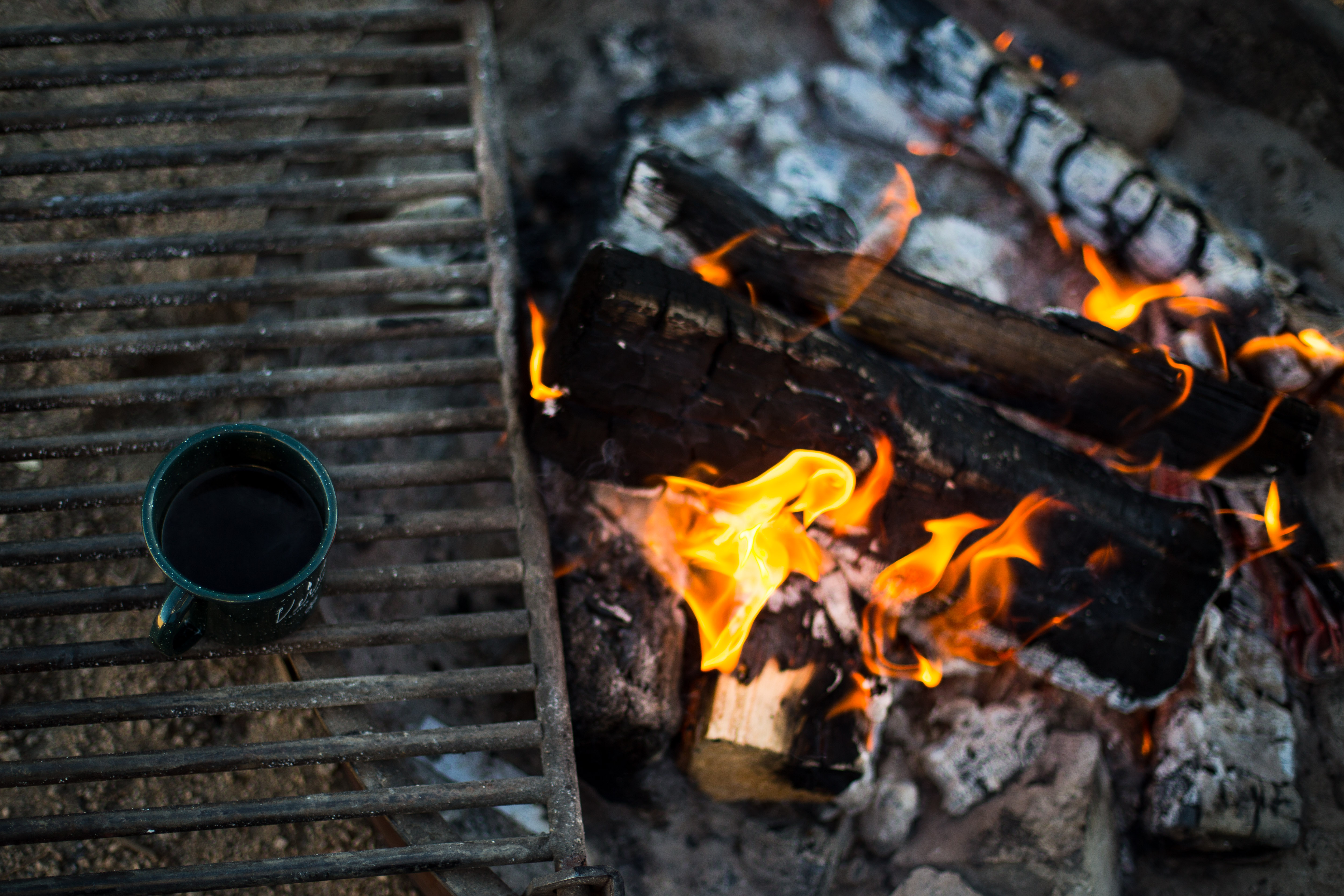 camping in the woods with a fire outdoors wood fire coffee mug camping and campfire hd photo by tim wright timdwright on unsplash