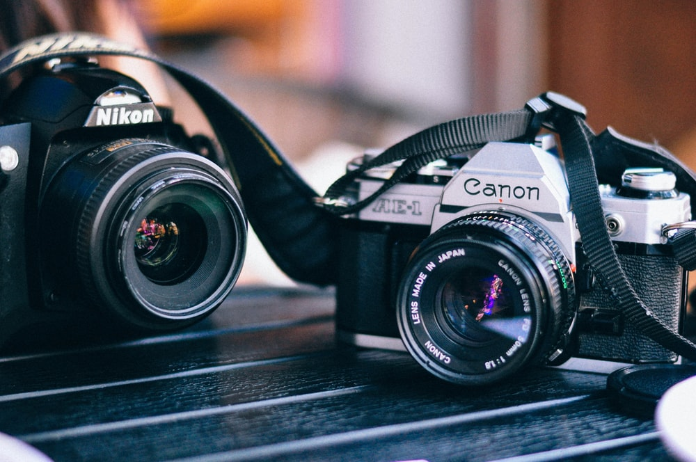 black Canon and Nikon camera in macro shot photography