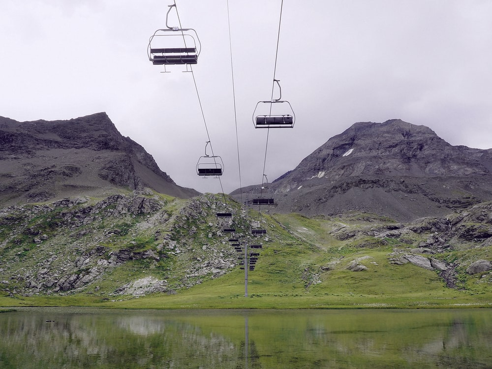 low-angle photography of cable cars