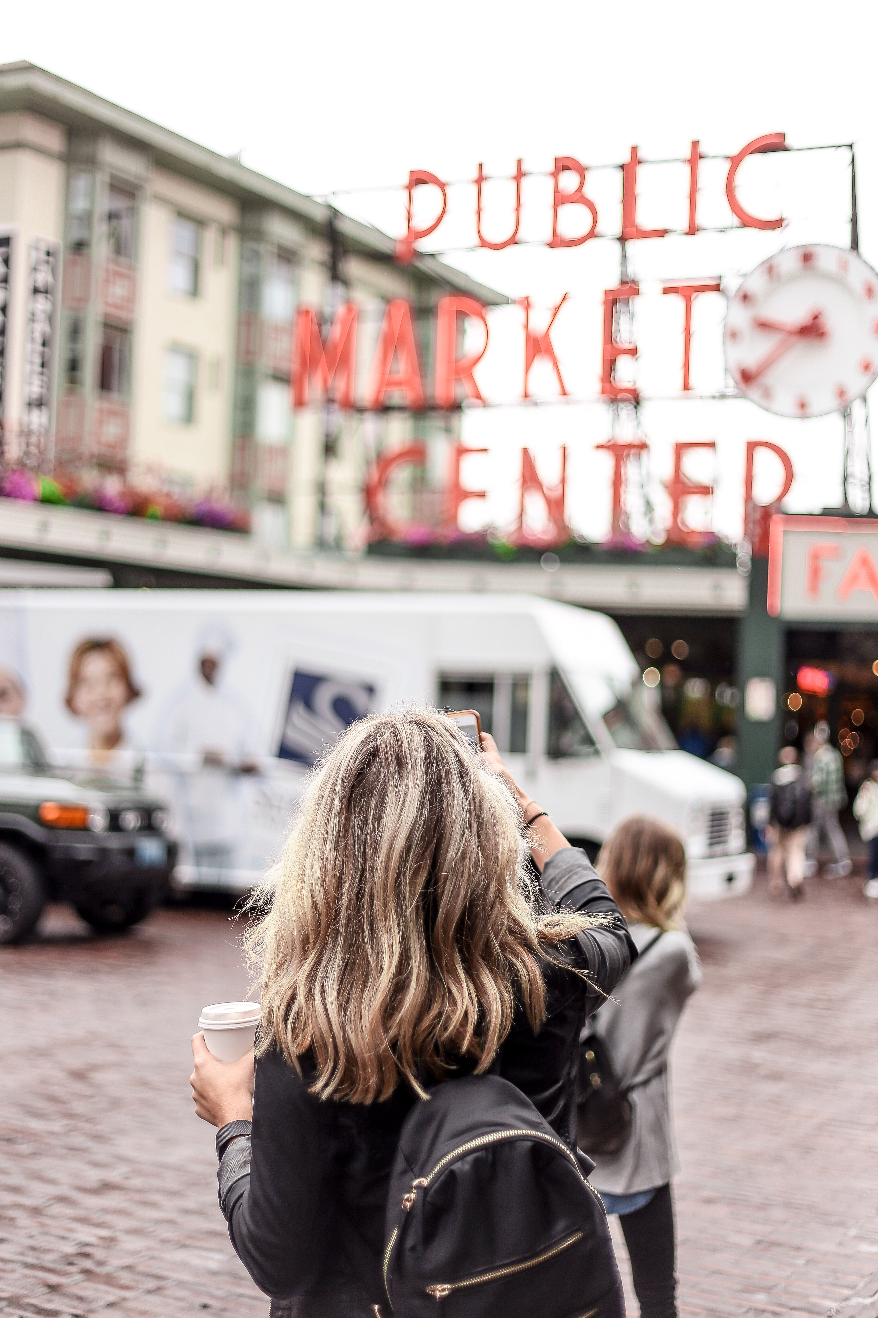 woman standing in front of Public Market Center