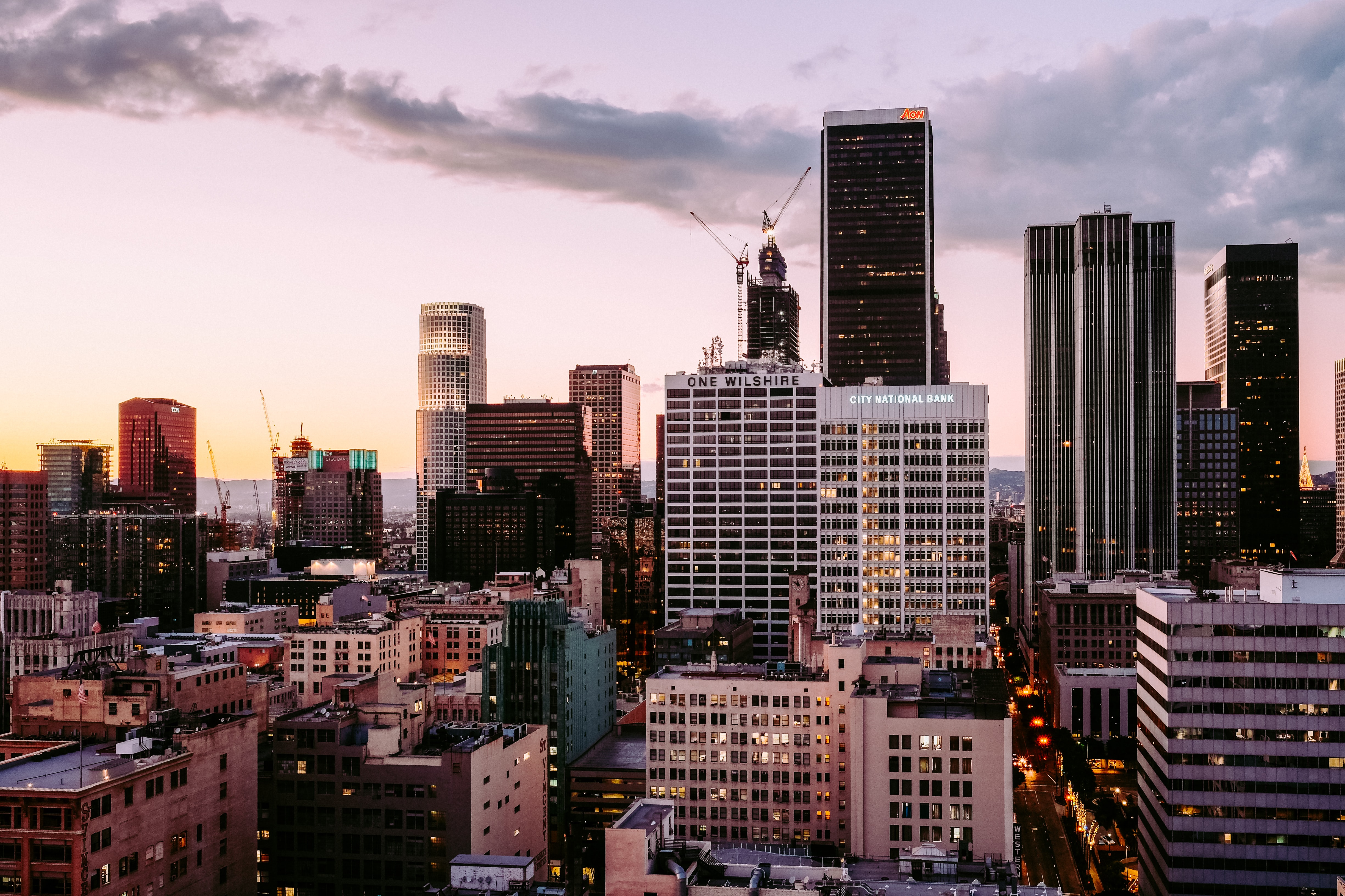 Sunset with streak of clouds covers the downtown Los Angeles sky, above One Wilshire Building and City National Bank