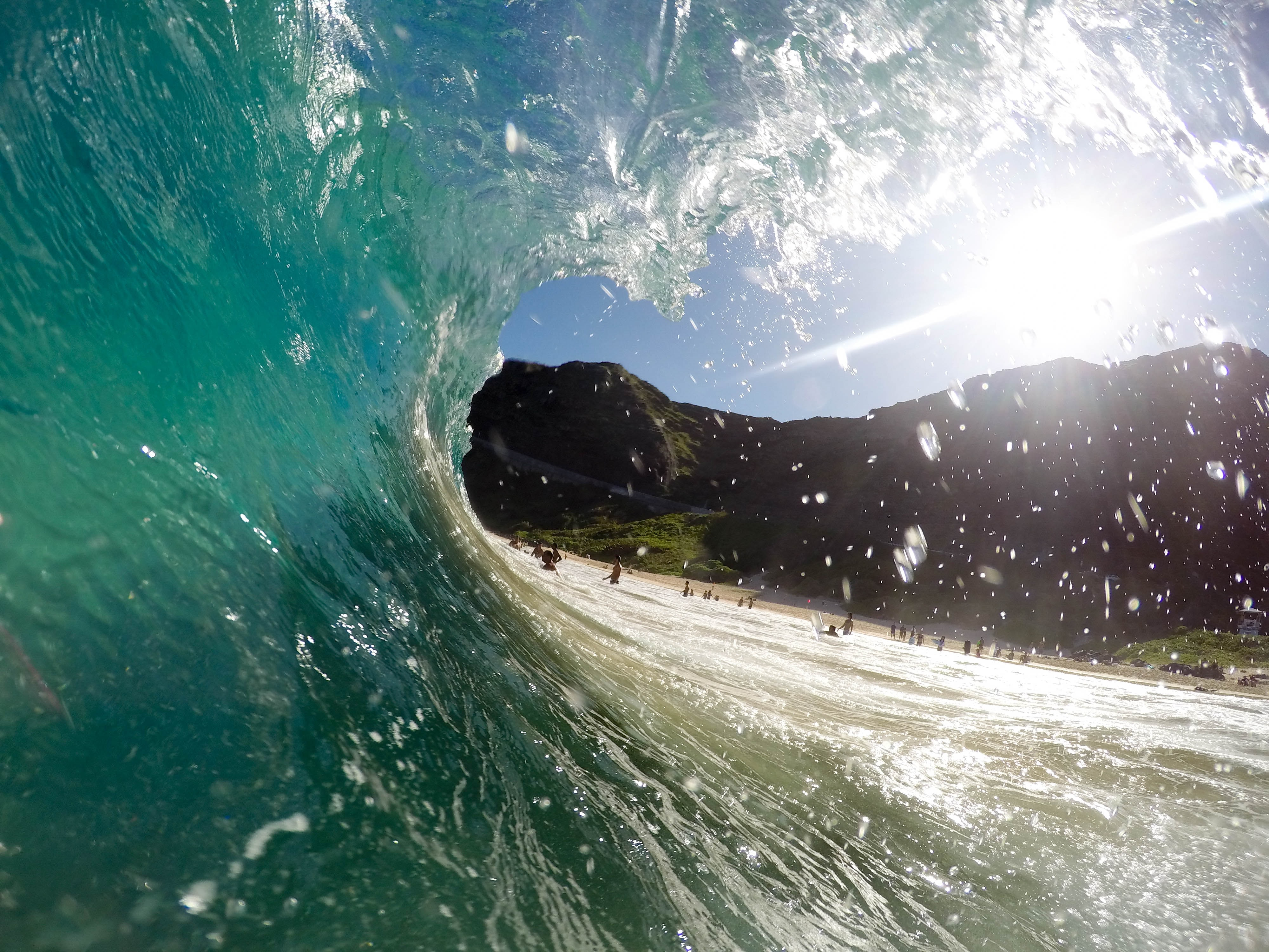Surfer's point of view riding a wave in O'ahu