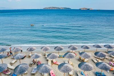 beach lounge on seashore facing the sea mediterranean teams background