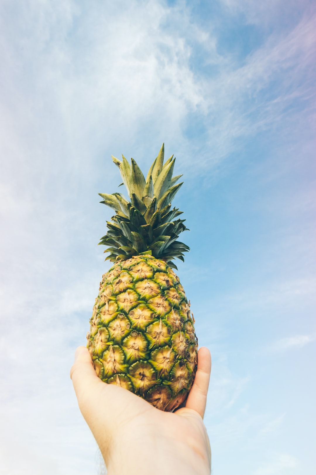 pineapple held up to the sky