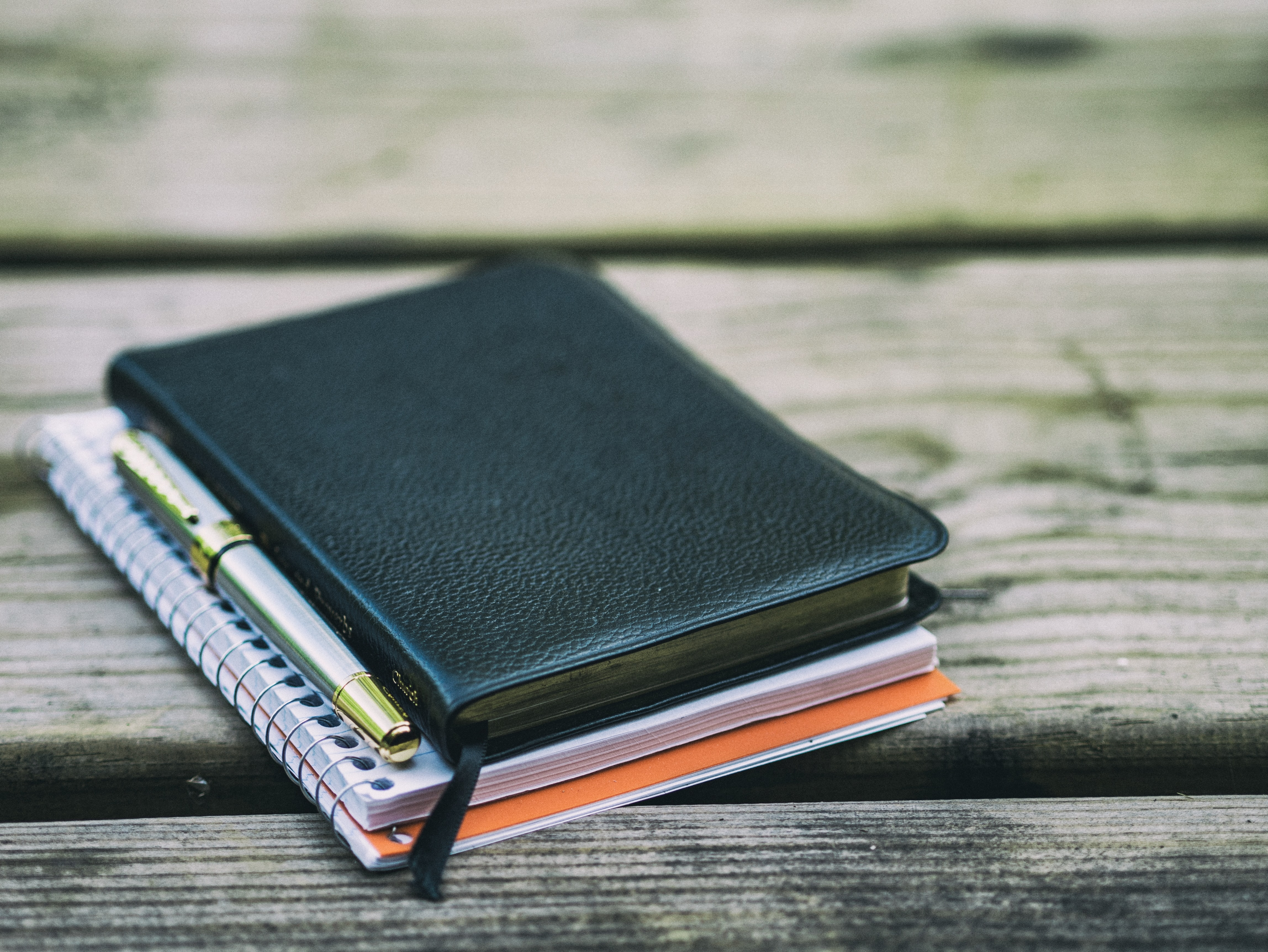Note books on a wooden deck.