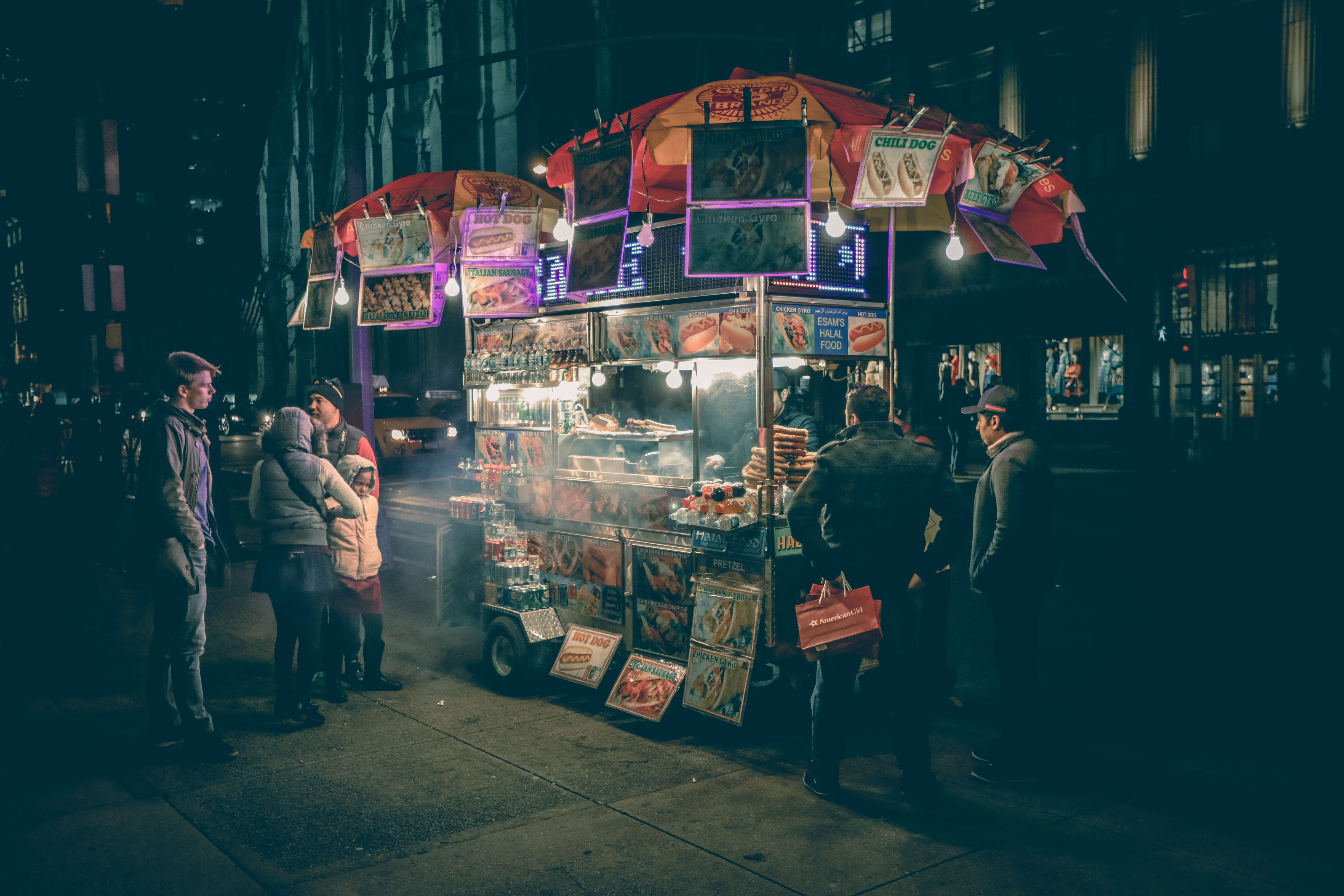 People checking out a downtown food vendor in New York