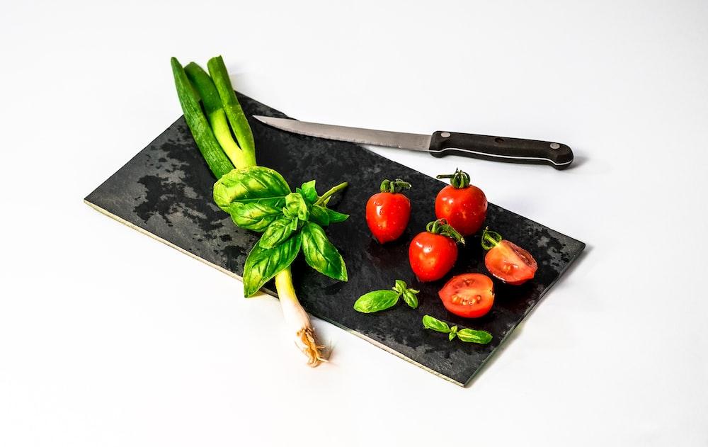 slice of tomato on board beside knife
