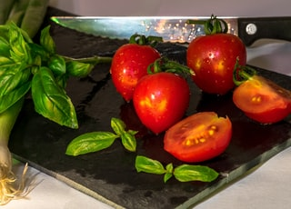 red tomatoes on black plate