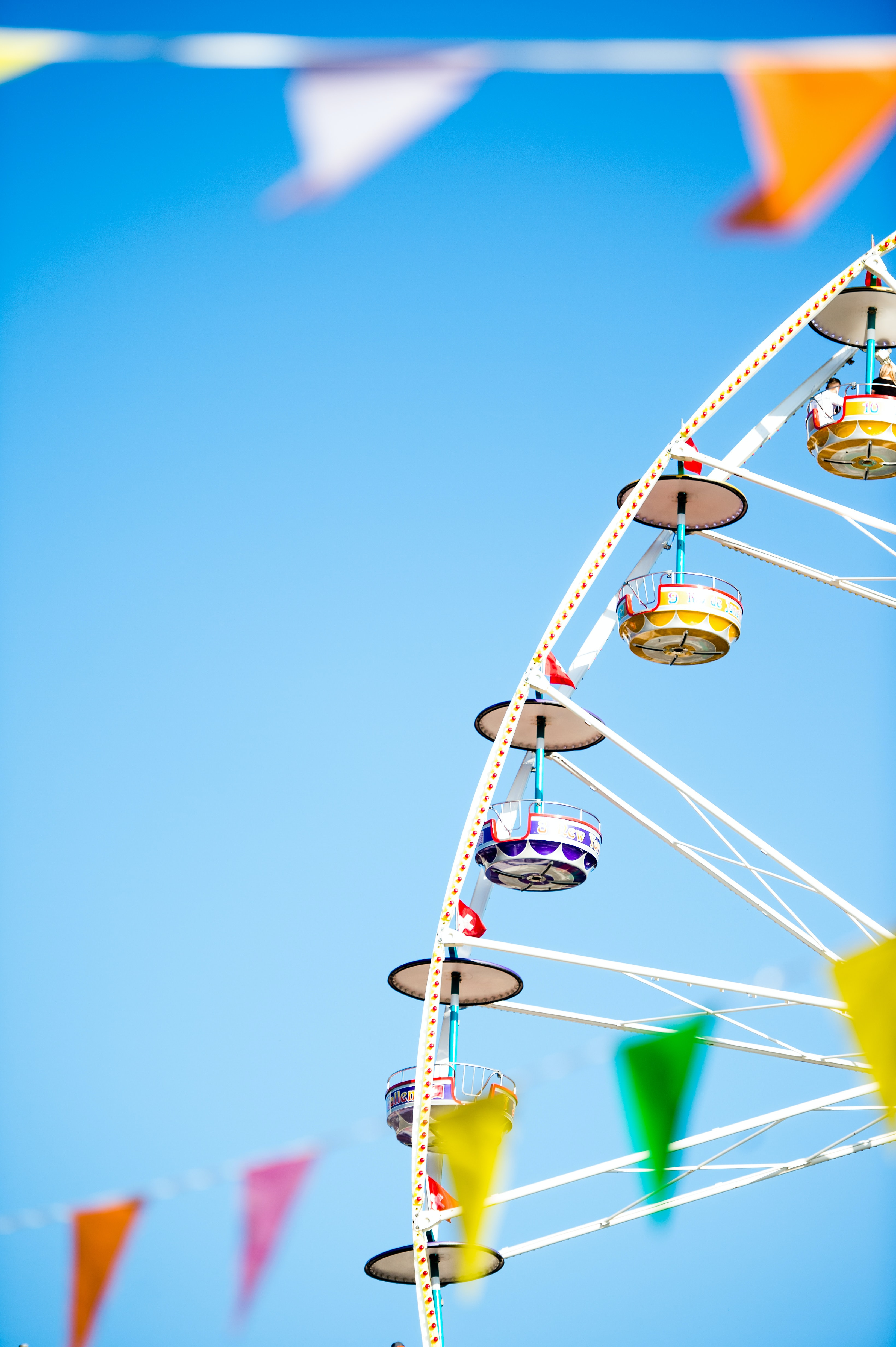 white and yellow Ferris wheel under blue skies photo