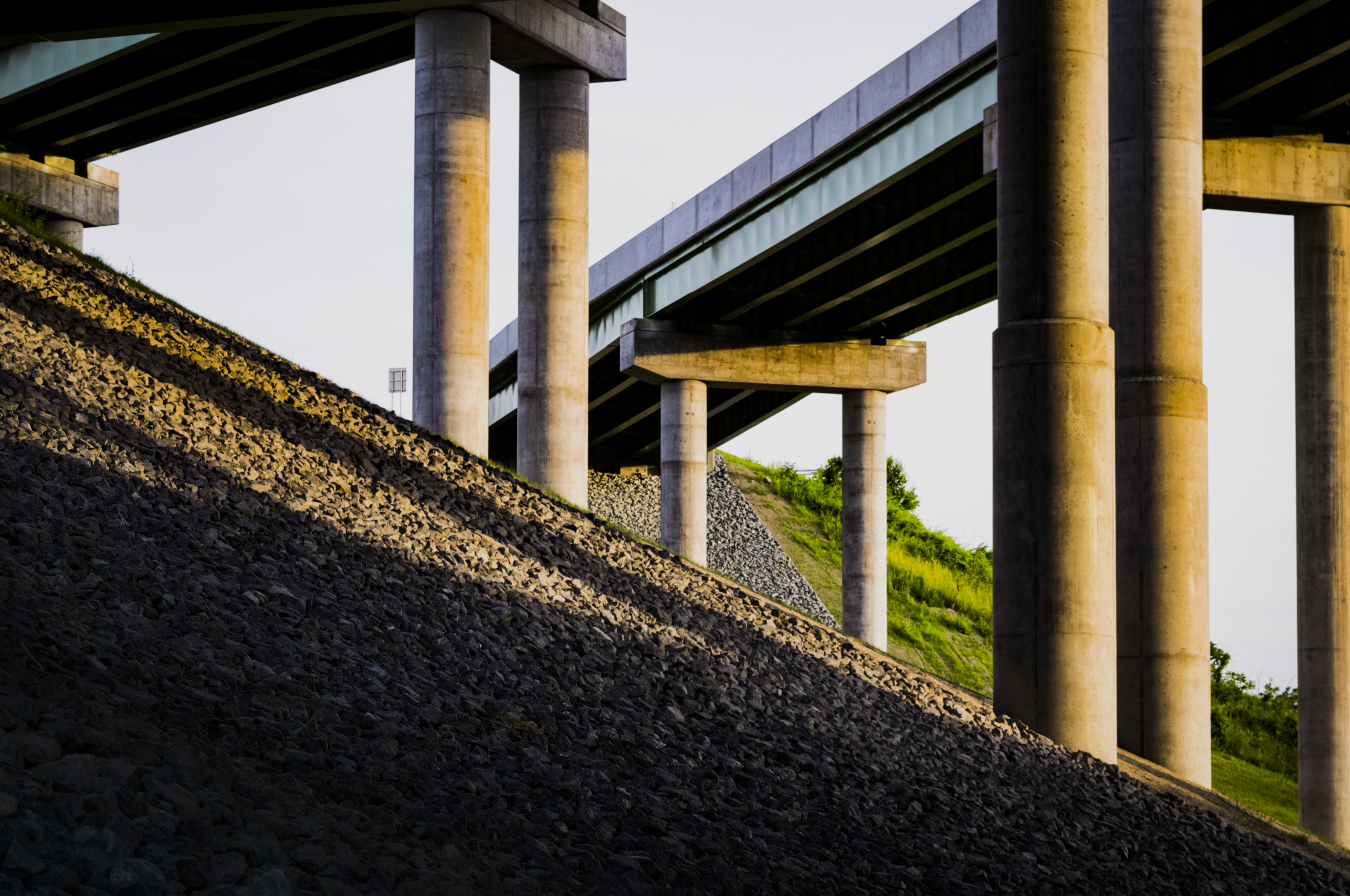 The support columns of multiple overpasses in Albany as seen from below.