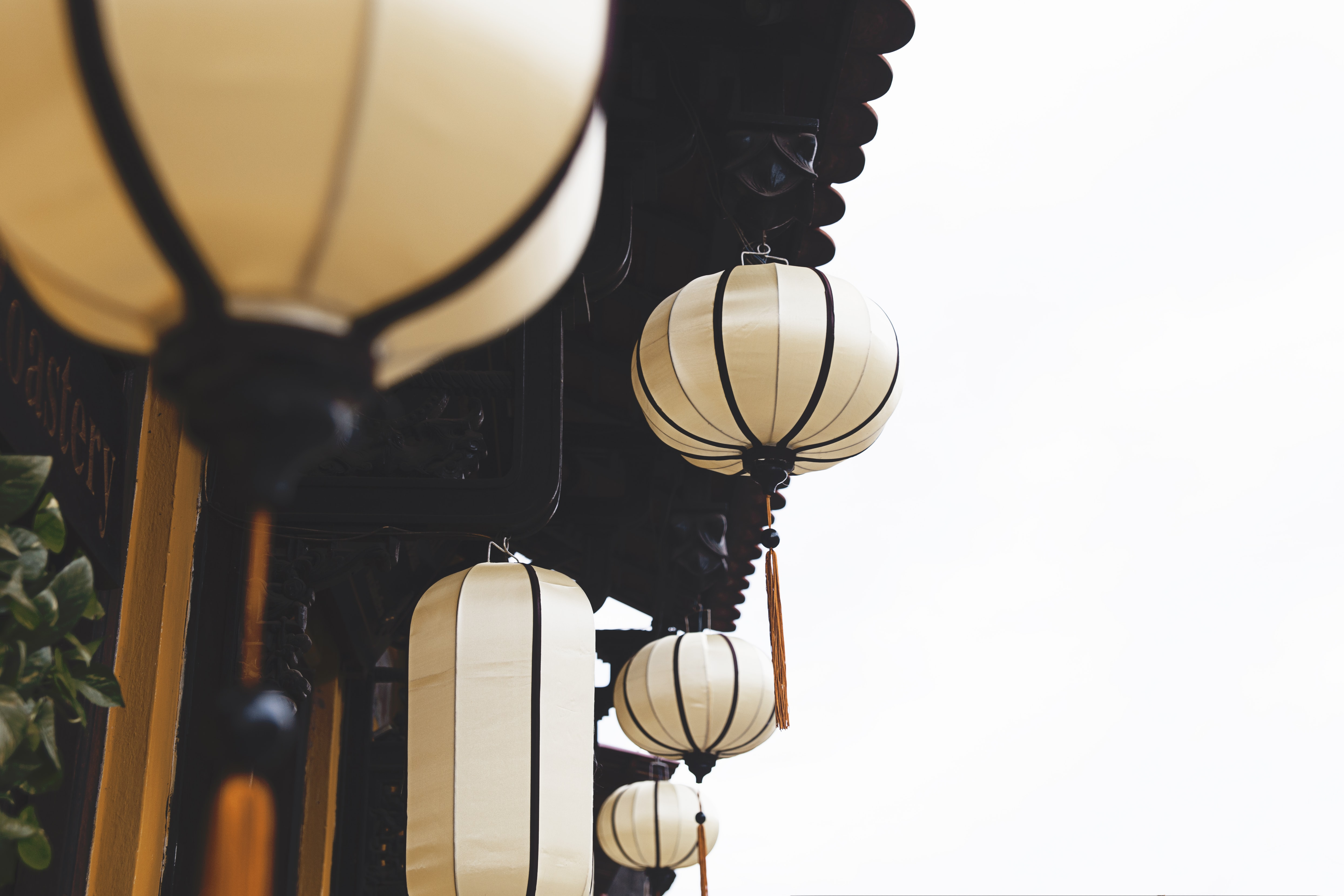 beige lantern hanging near house