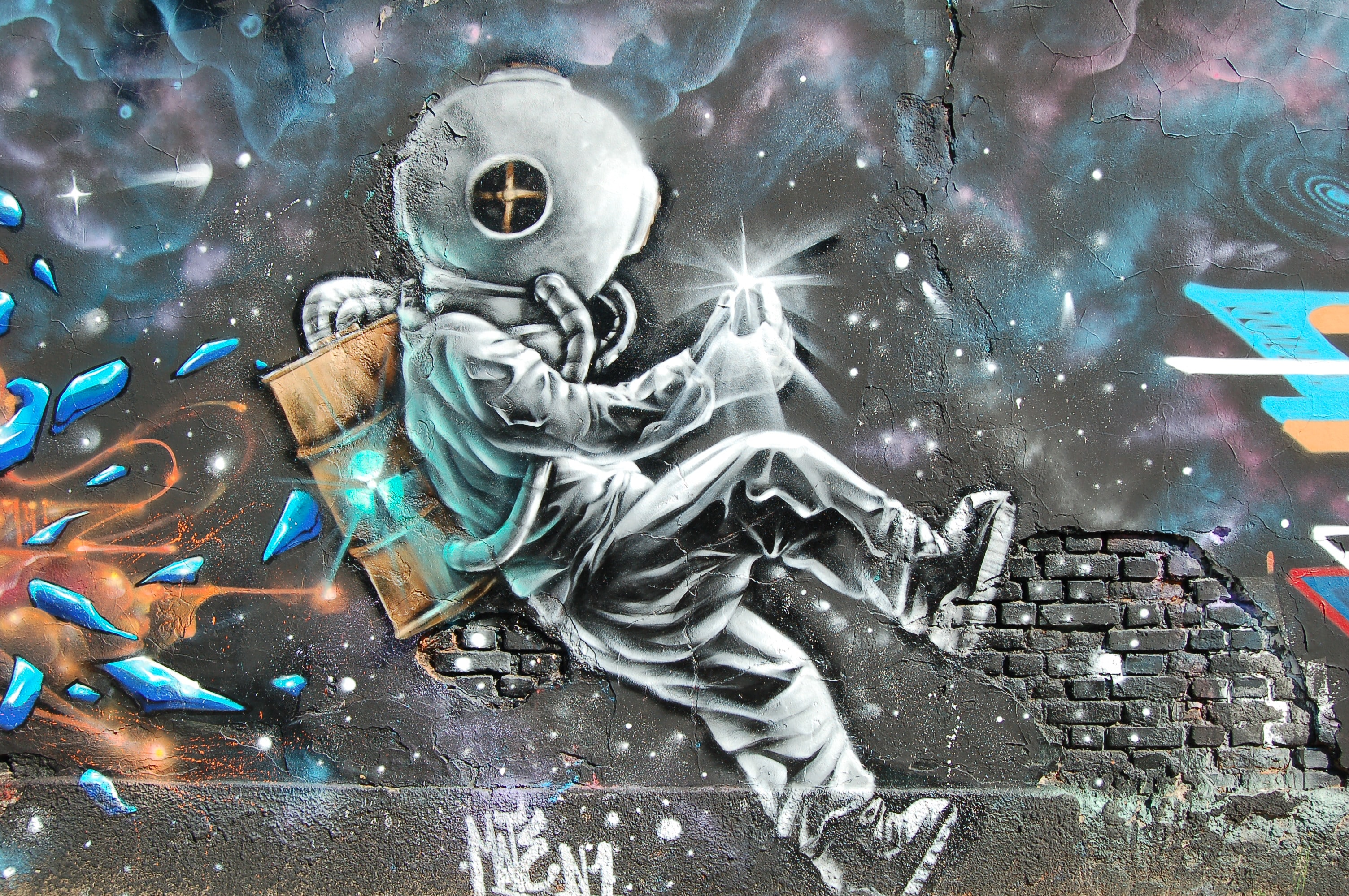 Graffiti art of an astronaut traveling through a colorful galaxy.