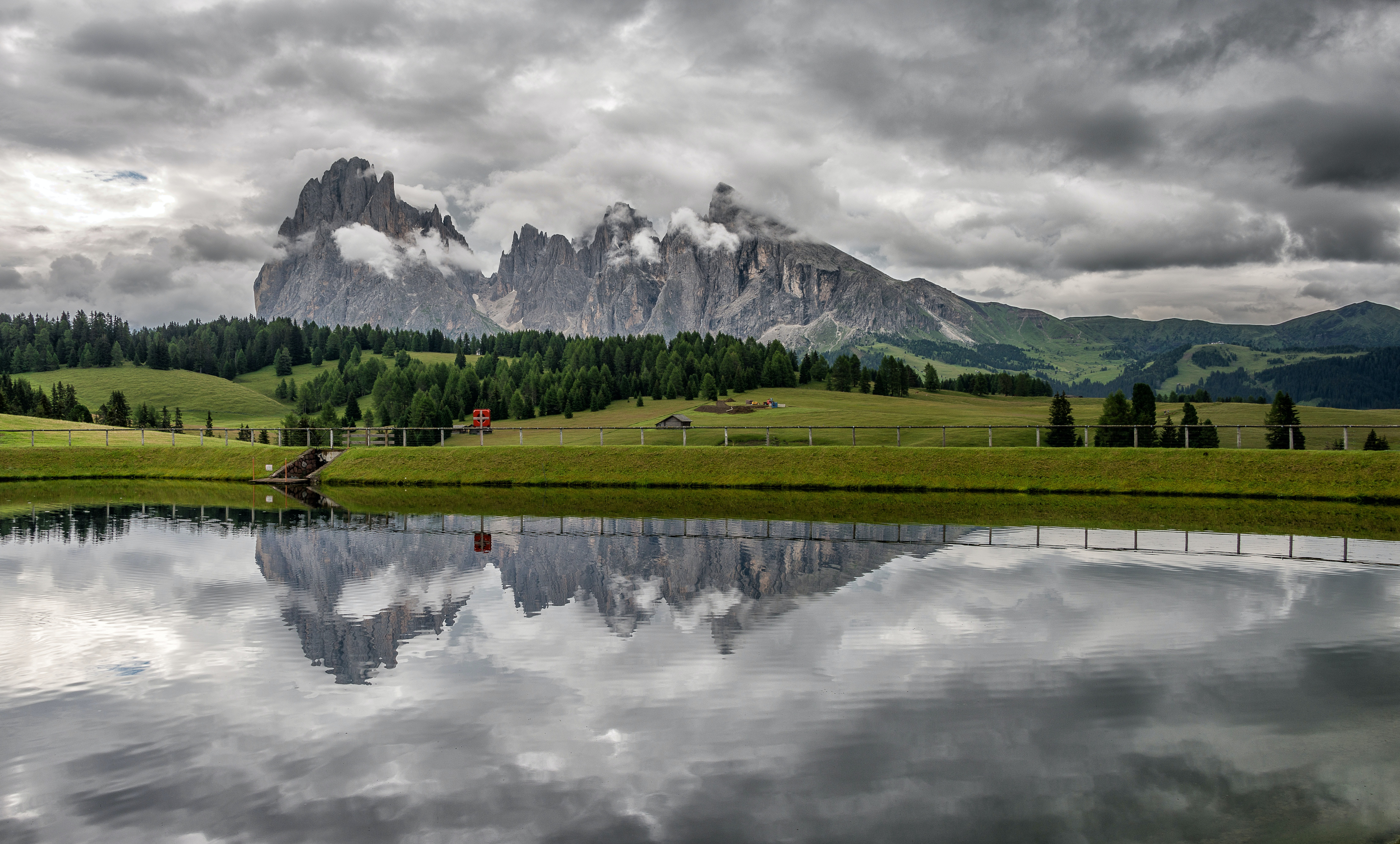 A beautiful enclosed lake with tall granite peaks on the horizon