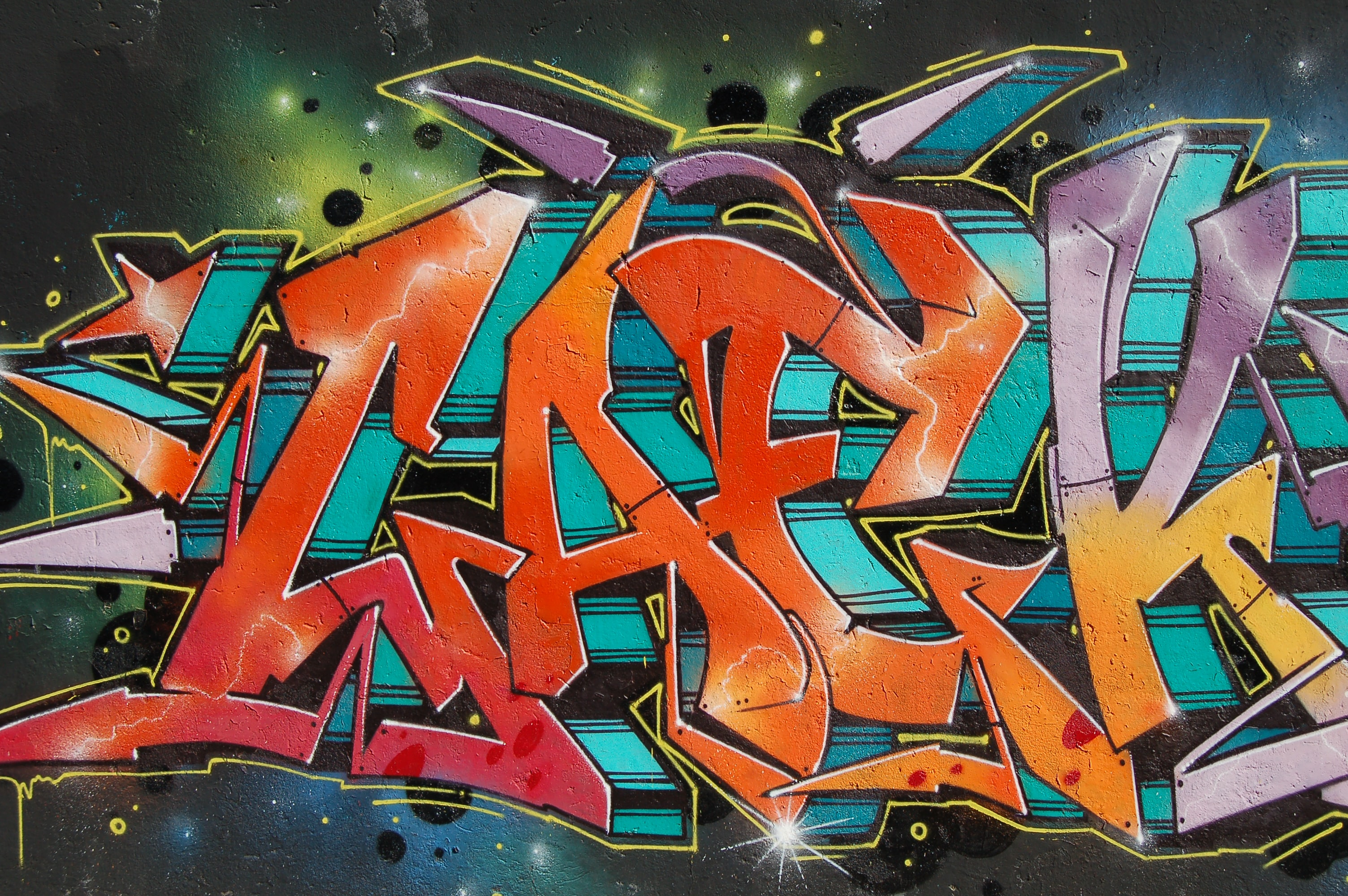orange and purple graffiti piece
