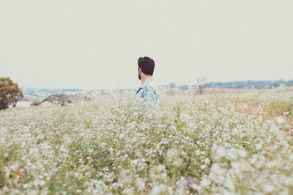 man in garden of flowers