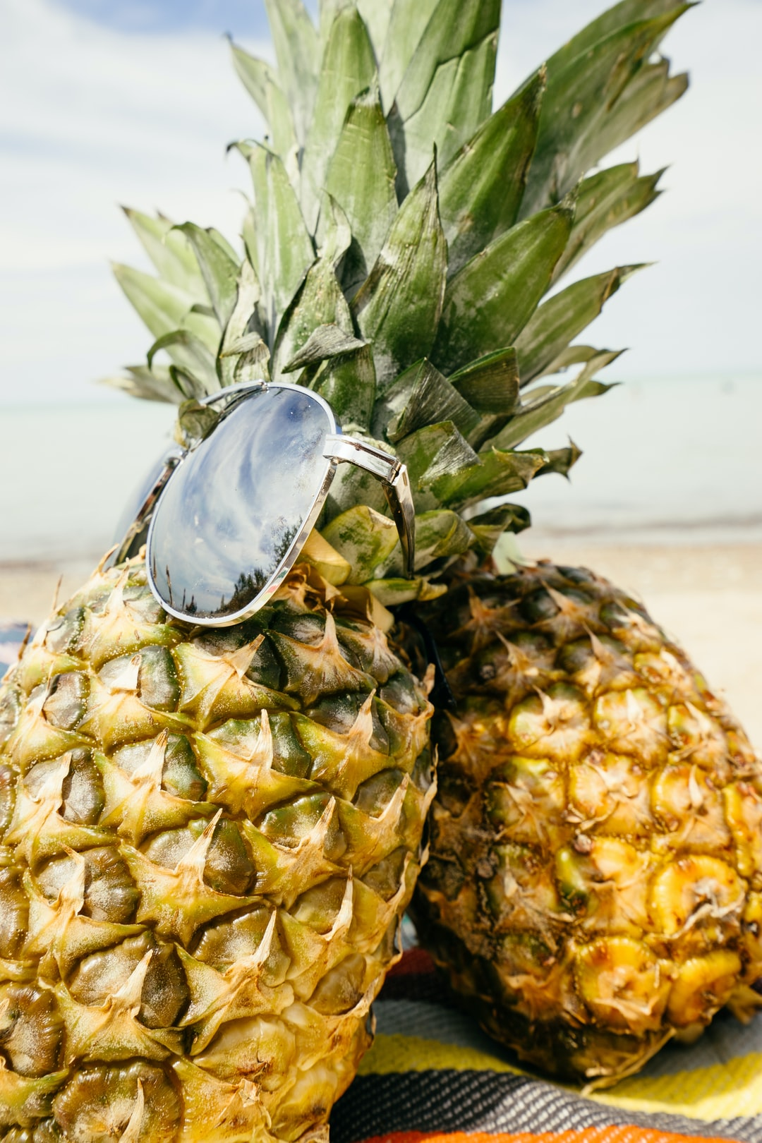 pineapple with sunglasses at the beach