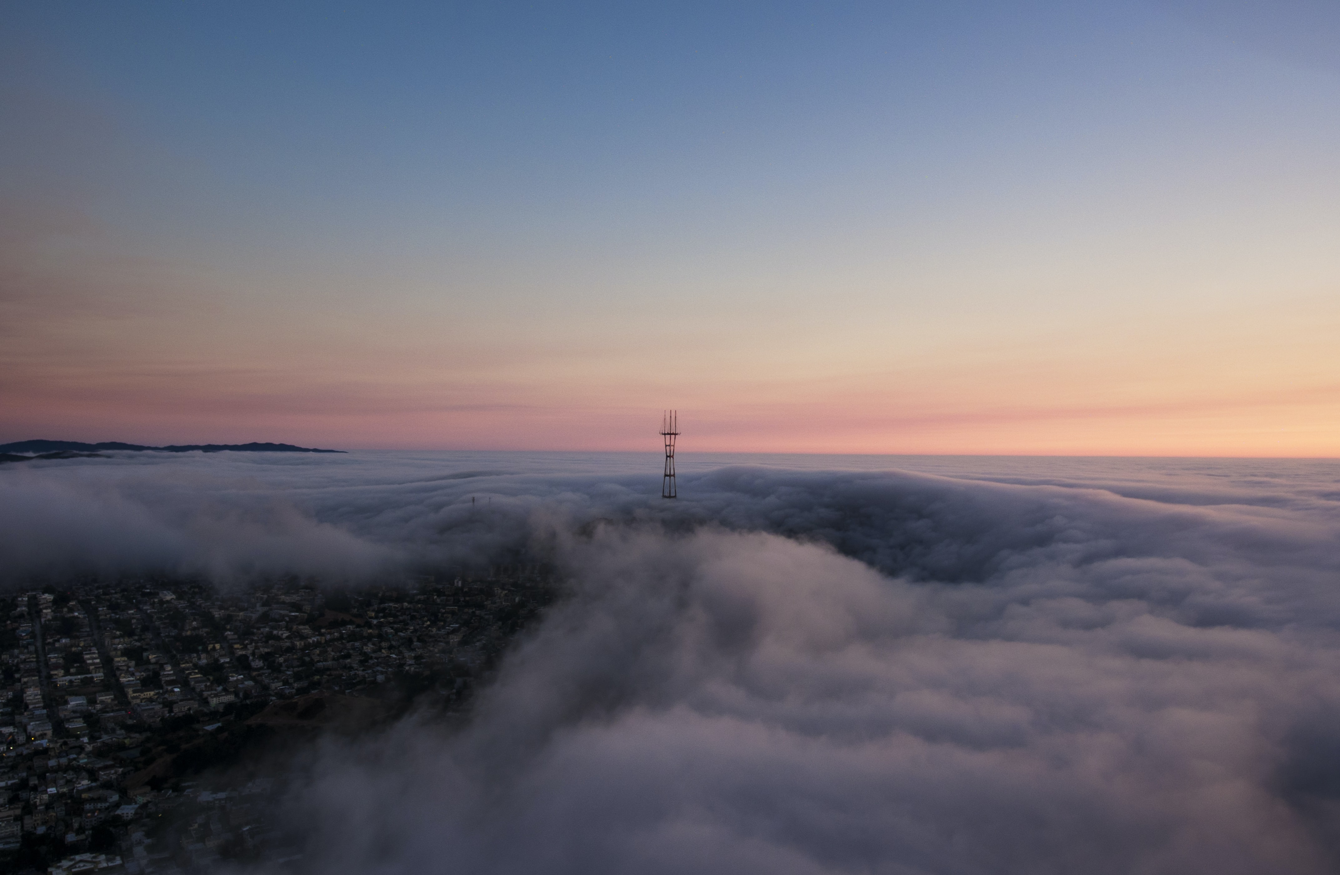 A drone shot aerial view of the clouds over Buena Vista Park at sunset
