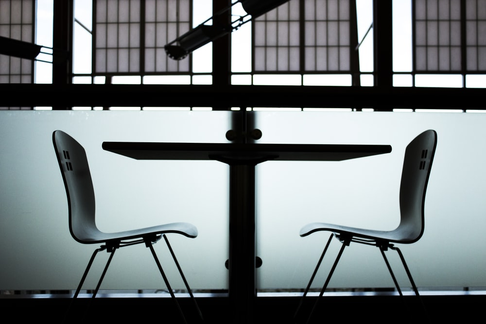 two gray steel chairs