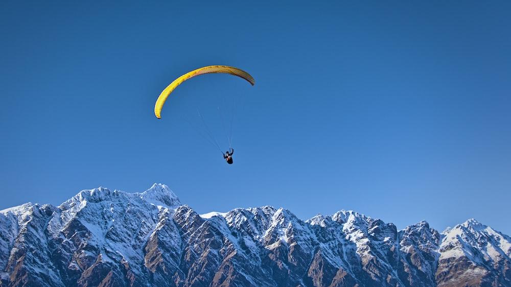 man on parachute near the mountain
